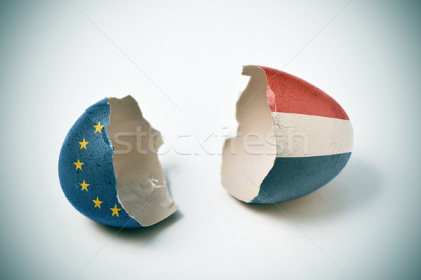 cracked eggshell patterned with the European and the Dutch flag Stock photo © nito