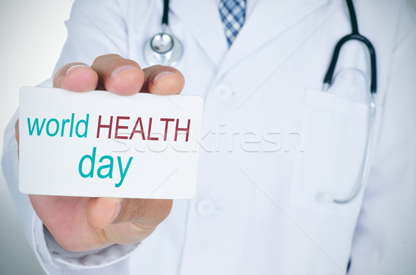 doctor with signboard with text world health day Stock photo © nito