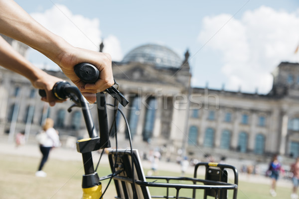 man riding a bike in front of the Reichstag Stock photo © nito