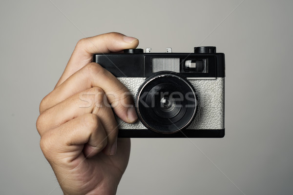 man with a film camera in his hand Stock photo © nito