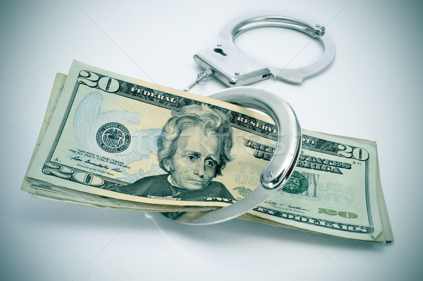 Bilincs dollár bankjegyek pár ötlet letartóztatás pénz Stock fotó © nito