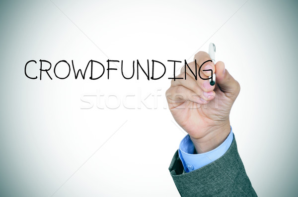 man writing the word crowdfunding Stock photo © nito
