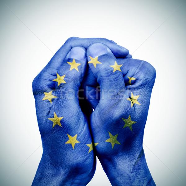 Europejski Unii ręce młody człowiek banderą podpisania Zdjęcia stock © nito