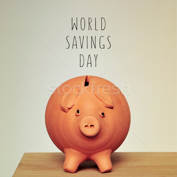 piggy bank and text world savings day Stock photo © nito