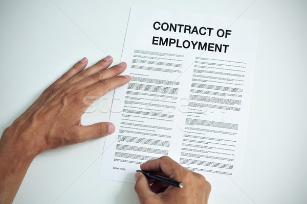 man signing a contract of employment Stock photo © nito