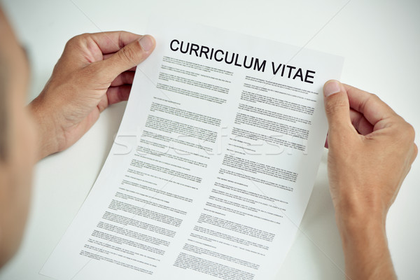 young man with a curriculum vitae Stock photo © nito