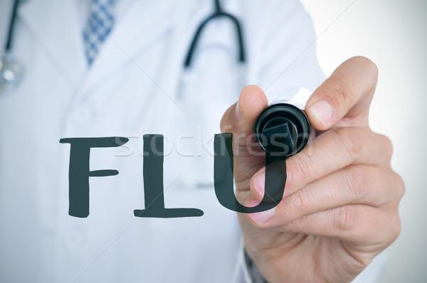 doctor man writing the word flu Stock photo © nito