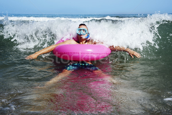 man on the sea with diving mask and swim ring Stock photo © nito