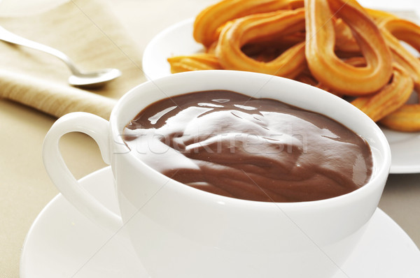 churros con chocolate, a typical Spanish sweet snack Stock photo © nito