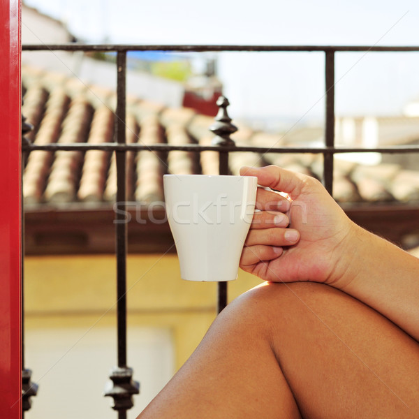 young man with a mug with coffee or tea Stock photo © nito
