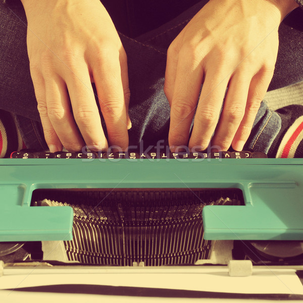 young man typewriting, with a retro effect Stock photo © nito