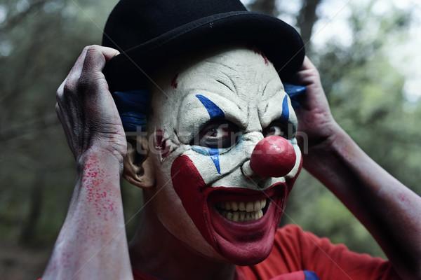 怖い 悪 ピエロ 森 クローズアップ 笑みを浮かべて ストックフォト © nito