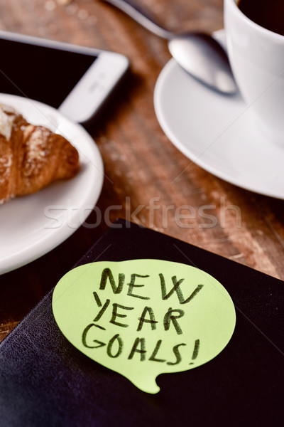 brekafast, smartphone and text new year goals Stock photo © nito
