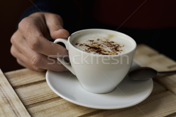 young man with a cup of cappuccino Stock photo © nito