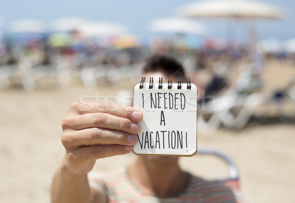 man with a note with the text I needed a vacation Stock photo © nito