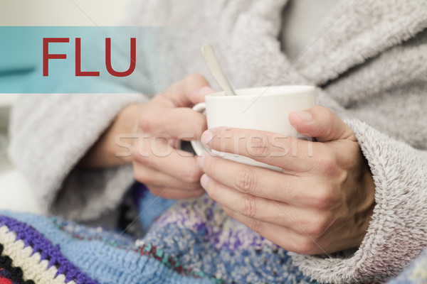 ill man with a cup of soup and the word flu Stock photo © nito