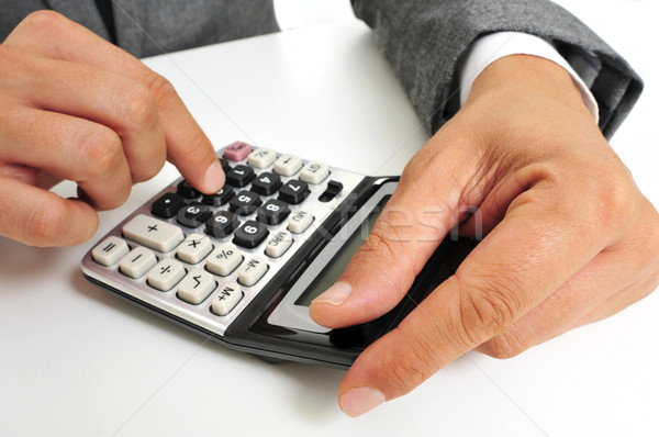 businessman using a calculator Stock photo © nito