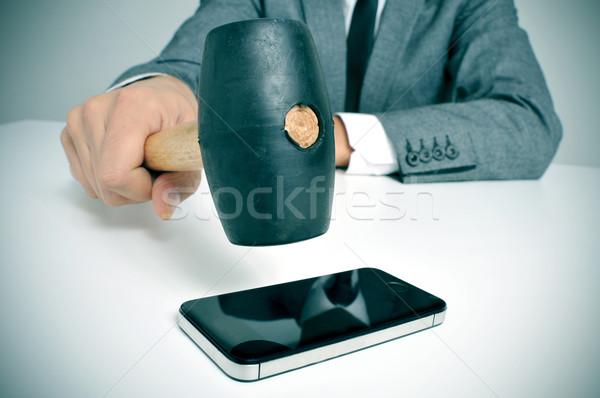 businessman broking a smartphone Stock photo © nito