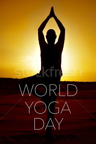 text world yoga day and yogi man doing the yoga tree pose Stock photo © nito