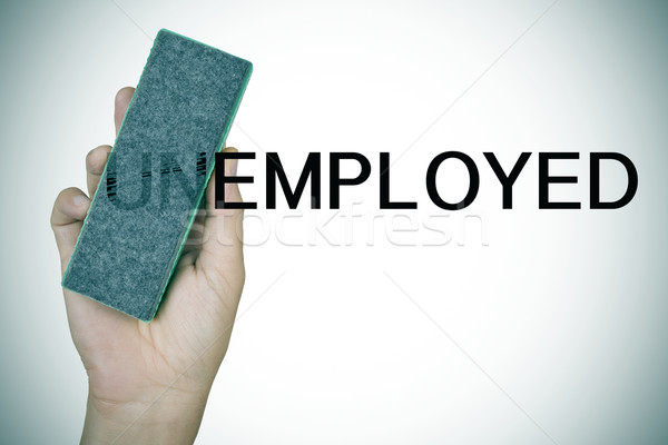 deleting the prefix UN in the word unemployed with an eraser Stock photo © nito