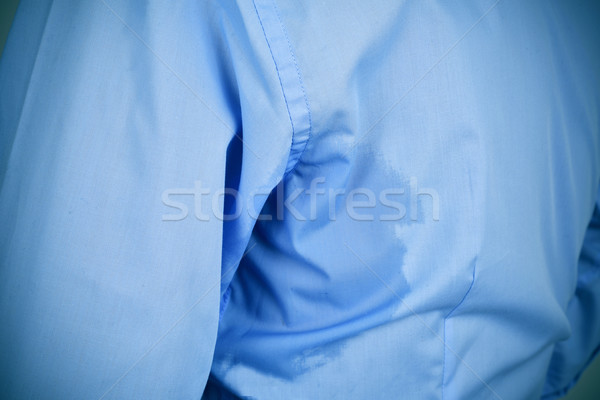 man with an underarm sweat stain Stock photo © nito
