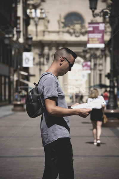 man observing a city map in Zaragoza, Spain Stock photo © nito