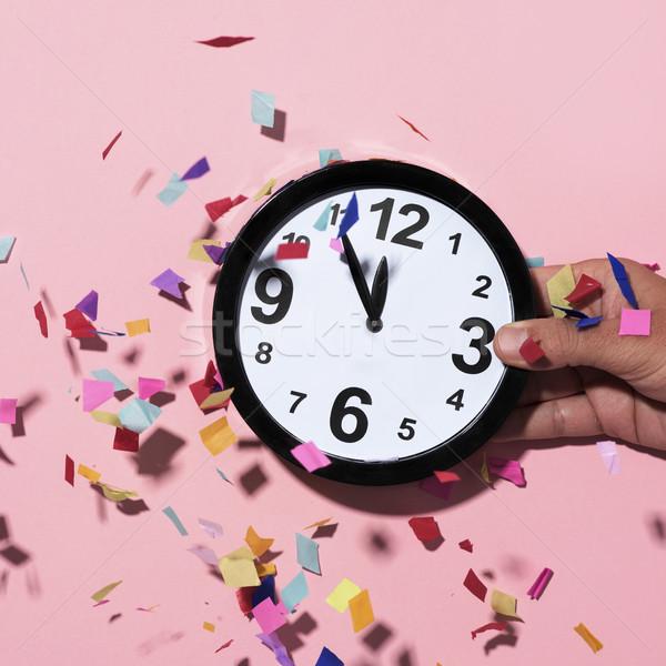 clock at five to twelve and confetti Stock photo © nito