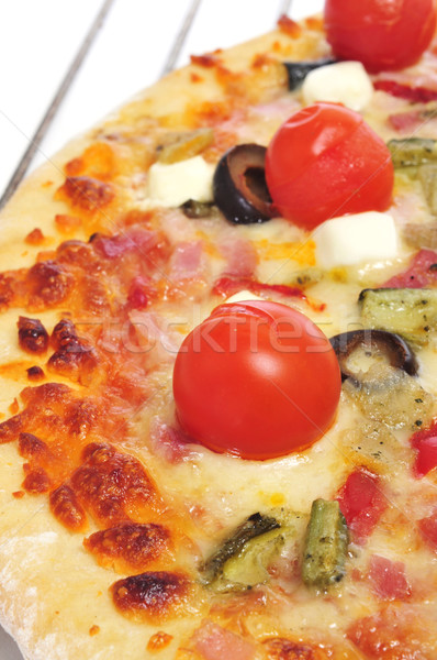 pizza with bacon, olives, cherry tomatoes, goat cheese, green pe Stock photo © nito