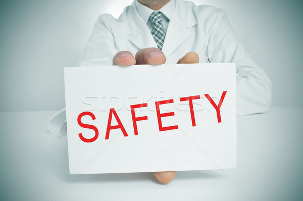 doctor showing a signboard with the word safety Stock photo © nito