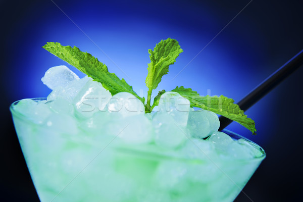 refreshing cocktail over a blue lighted background Stock photo © nito