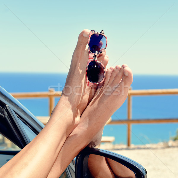 young man relaxing in a car near the ocean Stock photo © nito