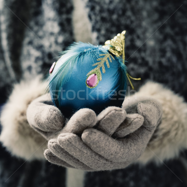 woman with an ornamented christmas ball Stock photo © nito