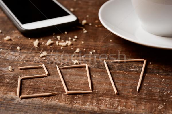 Smartphone café nombre nouvelle année rustique table en bois Photo stock © nito