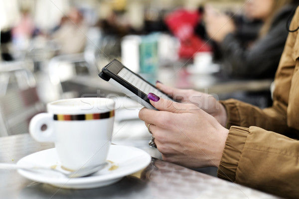 woman using a tablet in the terrace of a cafe Stock photo © nito