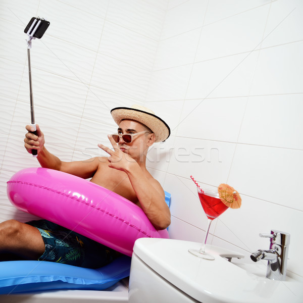 man with swim ring taking selfie in the bathroom Stock photo © nito