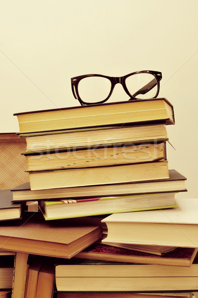 books and eyeglasses in an old suitcase, with a retro effect Stock photo © nito