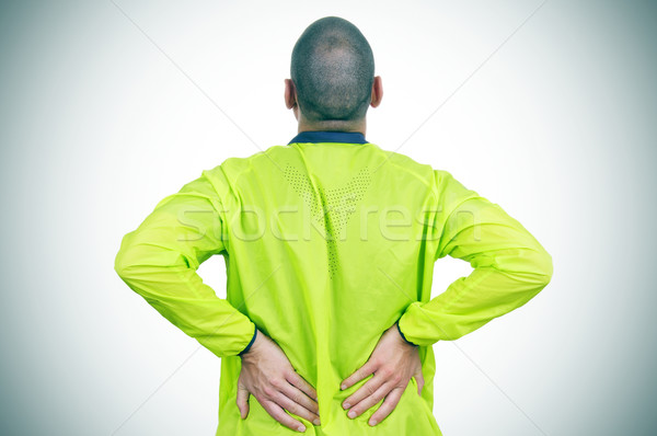 young sportsman with low back pain Stock photo © nito