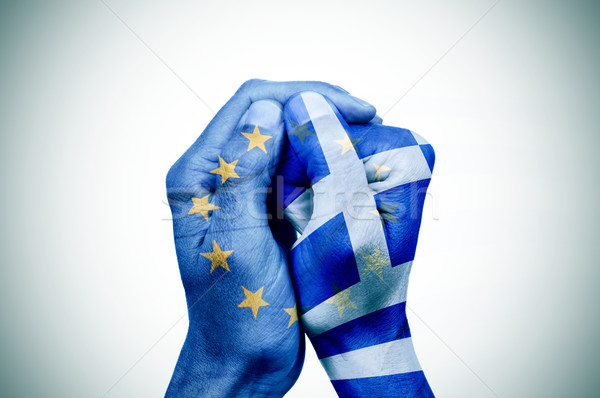 hands patterned with the European and the Greek flag put togethe Stock photo © nito