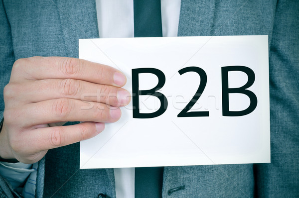 man in suit shows a signboard with the word B2B Stock photo © nito