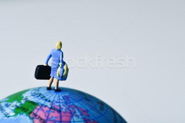 Minyatür gezgin kadın dünya arkasında Stok fotoğraf © nito