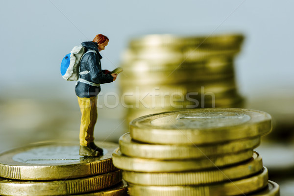 miniature traveler on a pile of euro coins Stock photo © nito