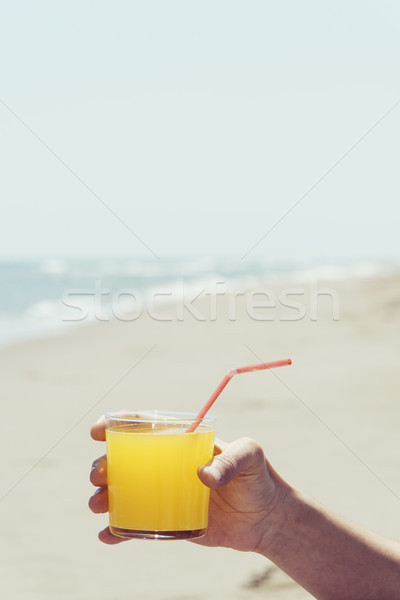 man with an orange drink on the beach Stock photo © nito