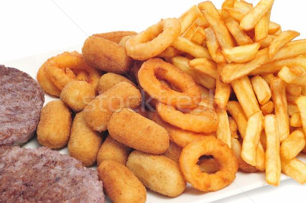 Taca tuczący żywności frytki gotować obiad Zdjęcia stock © nito