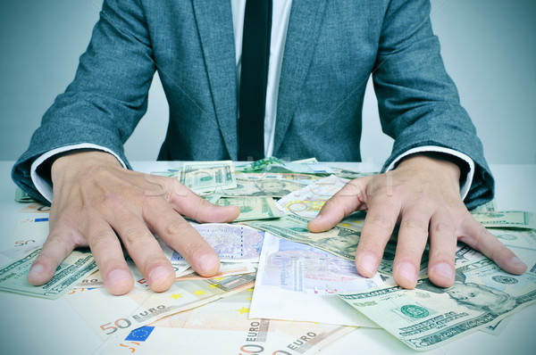 man in suit with dollar and euro bills Stock photo © nito