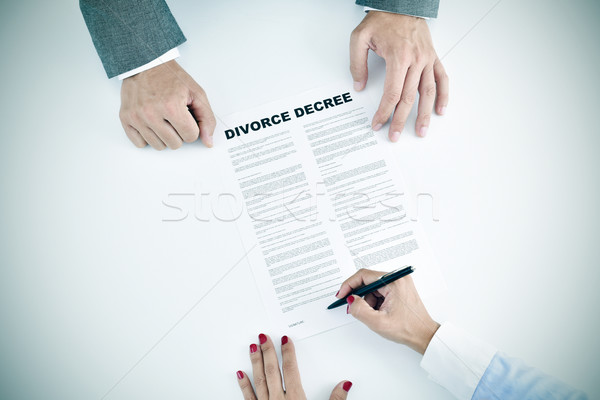 young woman signing a divorce decree document Stock photo © nito