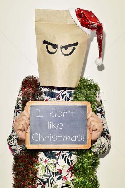 young man who dont like christmas Stock photo © nito
