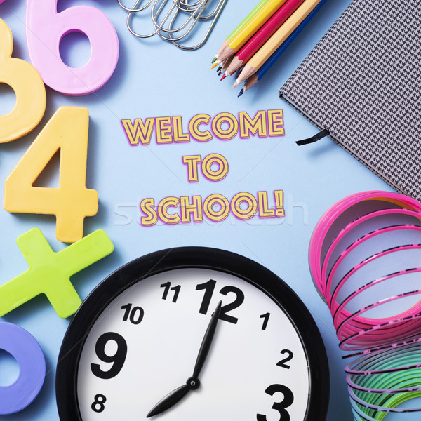 stationery, clock and text welcome to school Stock photo © nito