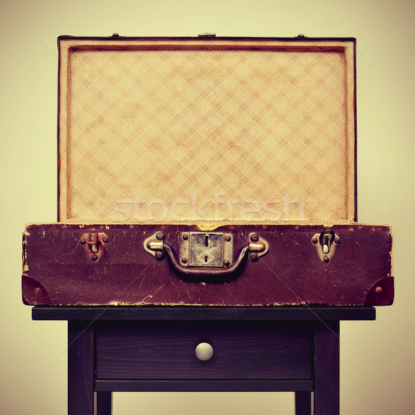 old suitcase on a table, with a retro effect Stock photo © nito
