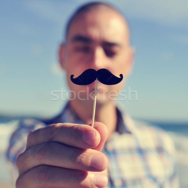 Junger Mann Fake Schnurrbart halten Stick Gesicht Stock foto © nito