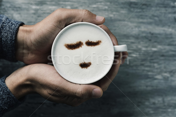 Jeune homme tasse cappuccino coup jeunes Photo stock © nito